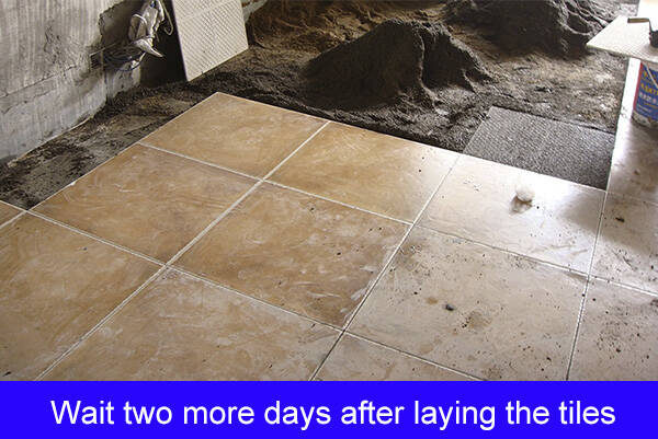 Doing the grouting of tile joints immediately after paving tilesDoing the grouting of tile joints immediately after paving tiles