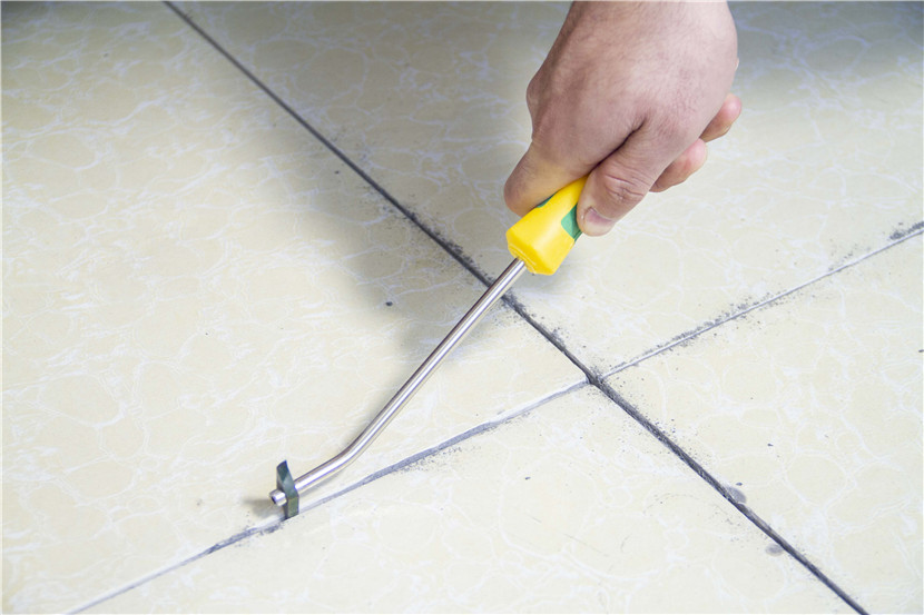 Use a spatula or a cleaning cone to scrape out the tile grout a little